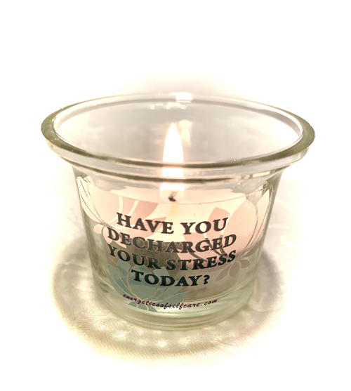votive candle holder with inscription Have You Decharged Your Stress Today and candle